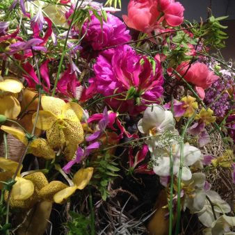 Blumengesteck Clematis Orchideen